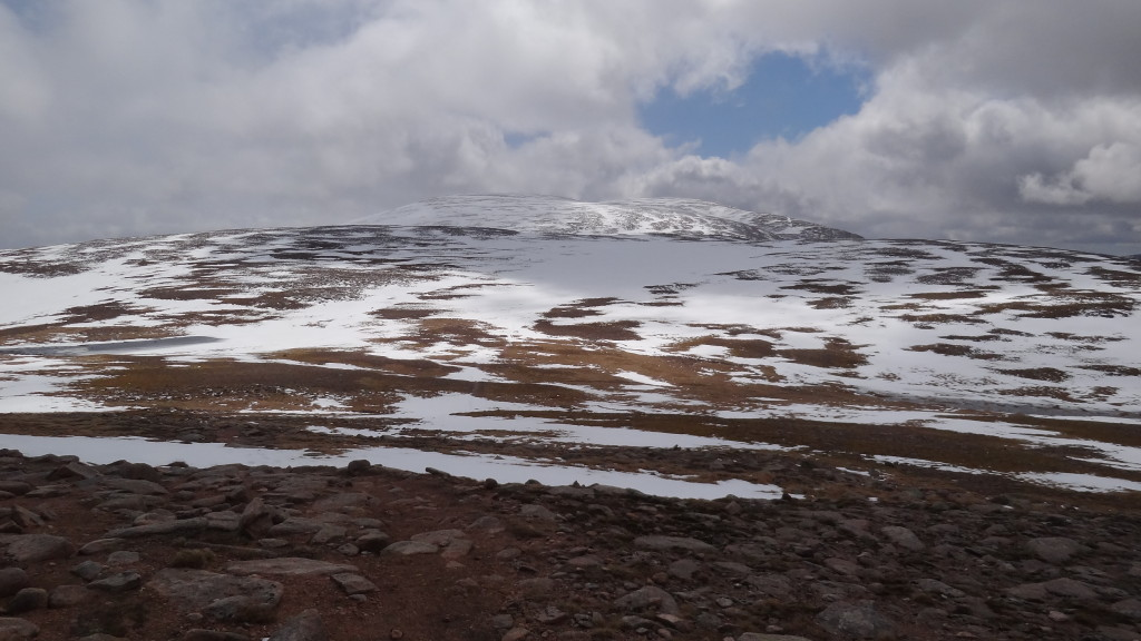 Mountain party covered in snow, with a path no longer visible