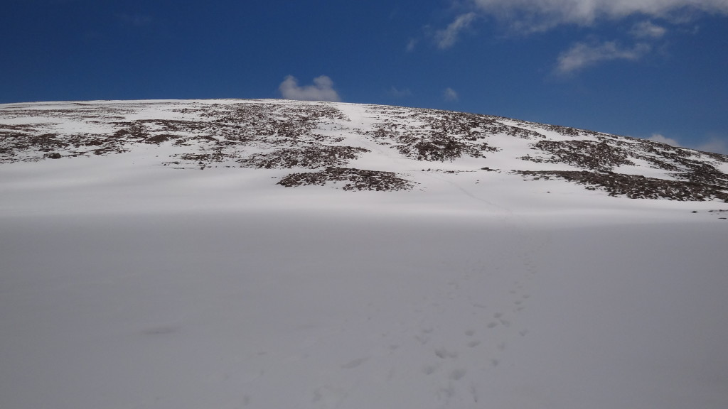 Footprint in the snow leading to the top of the mountain