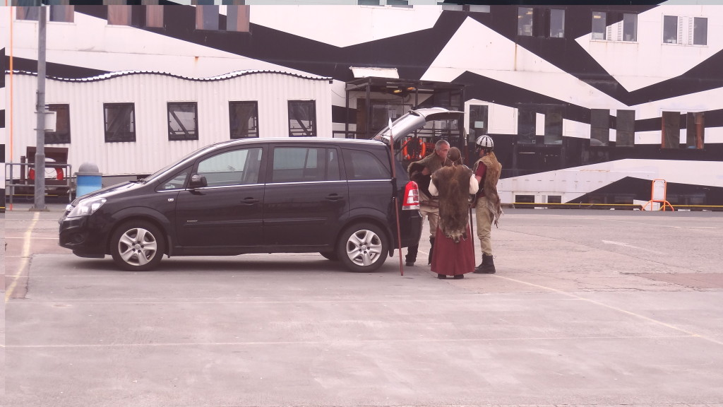 People dressed as Vikings getting out of a car