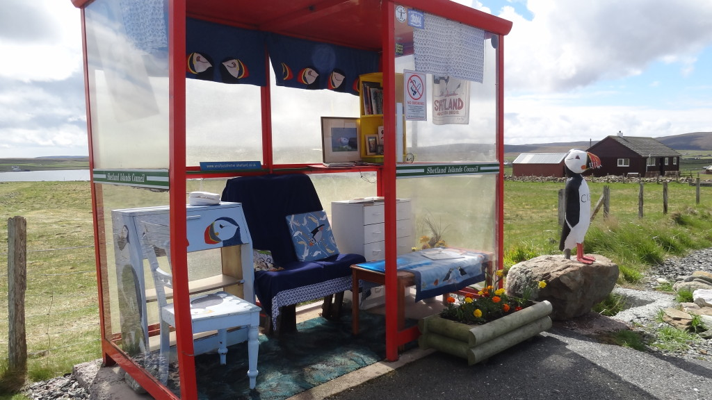 Bus shelter decorated with puffins