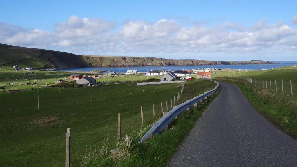 Village view, cliffs in the background