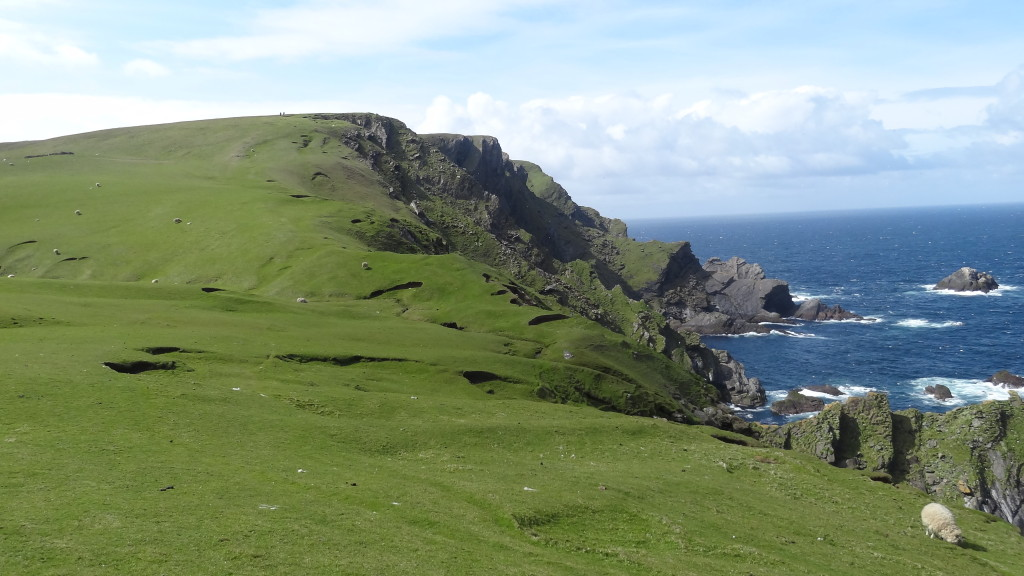 Rolling green hills and cliffs