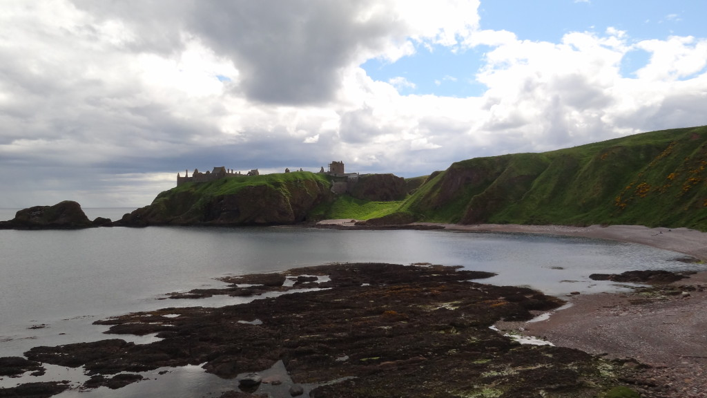beach with Stonehaven castle in the background