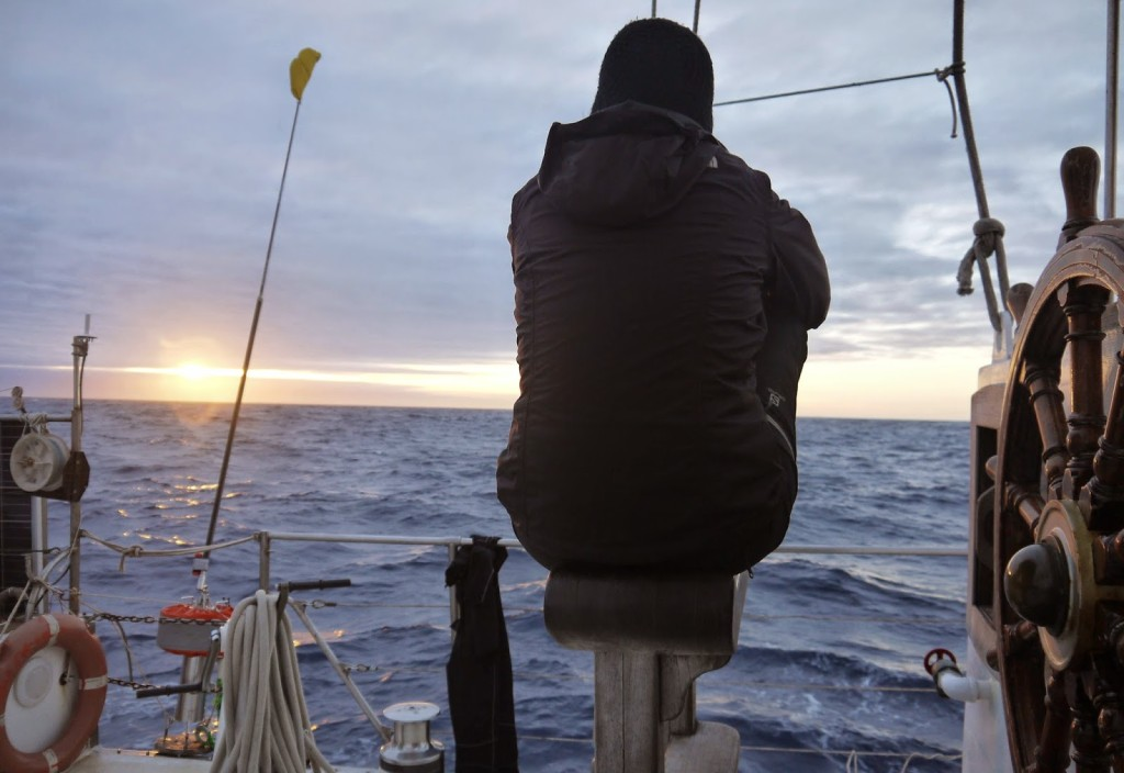 Sitting at the helm of a sailboat, getting lost in the ocean