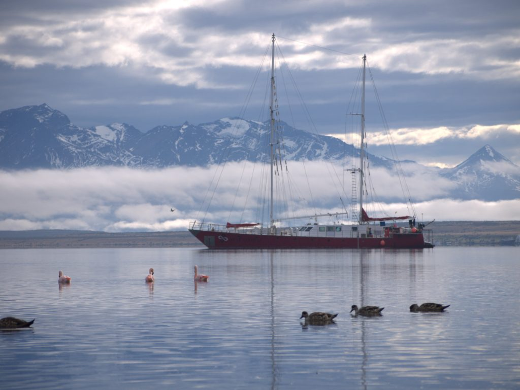 Infinity Expedition - Sailing vessel Infinity with mountains in the background