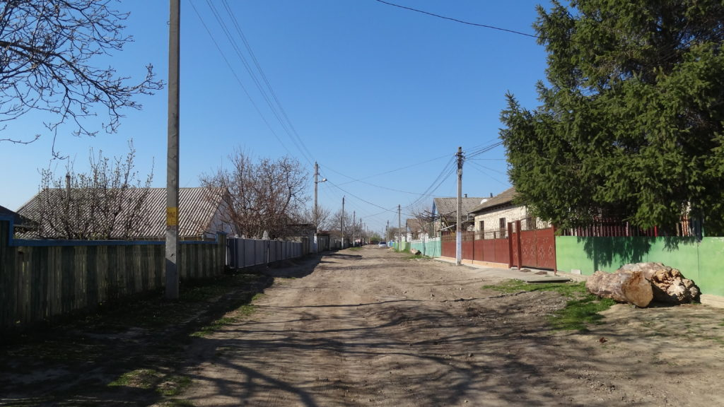 Unpaved street, dusty when dry, very muddy and slippery when wet