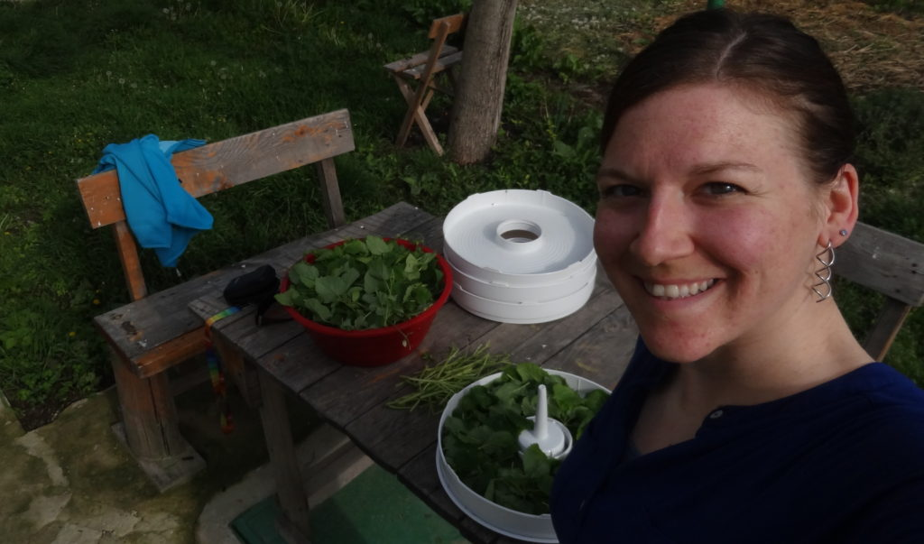 Happily cutting herbs to dry them