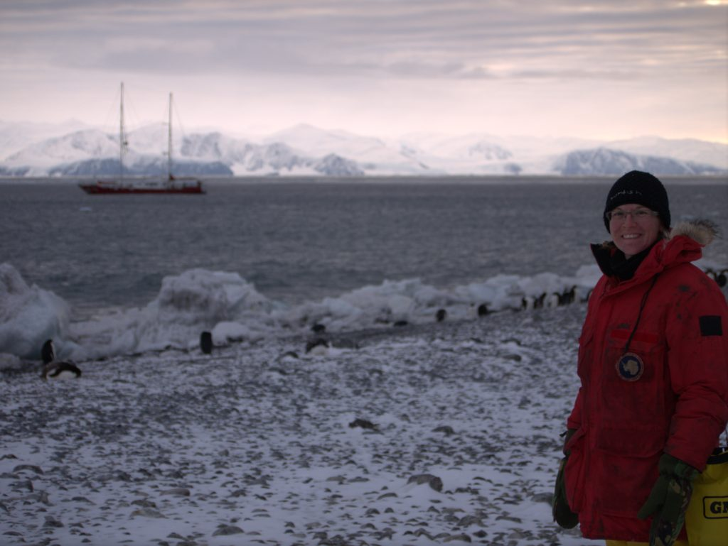Infinity Expedition - Me on Ridley Beach, Antarctica with penguins and Infinity in the background