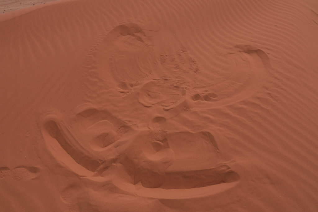 Sand angel, a lot warmer to do than snow angels!