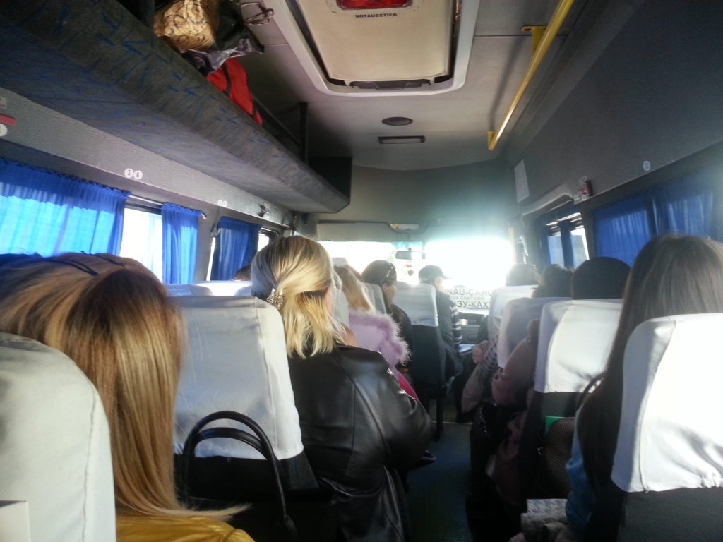 People sitting on a minibus