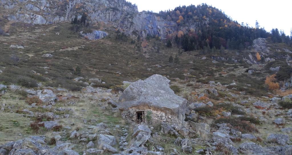 Shepherds shelter under a rock